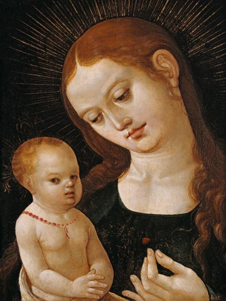 A person holding a baby  Description automatically generated
